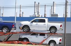 A car hauler transports new Dodge Ram pickup trucks from the Fiat Chrysler Automobiles (FCA) Warren Truck Assembly plant in Warren, Michigan October 7, 2015. REUTERS/Rebecca Cook