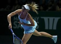 Maria Sharapova of Russia serves to Agnieszka Radwanska of Poland during their women's singles tennis match of the WTA Finals at the Singapore Indoor Stadium October 25, 2015. REUTERS/Edgar Su  -