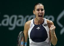 Flavia Pennetta of Italy celebrates a point against Agnieszka Radswanka of Poland during their women's singles tennis match of the WTA Finals at the Singapore Indoor Stadium October 27, 2015. REUTERS/Edgar Su