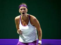 Petra Kvitova of the Czech Republic celebrates a point against compatriot Lucie Safarova during their women's singles tennis match of the WTA Finals at the Singapore Indoor Stadium October 28, 2015. REUTERS/Edgar Su