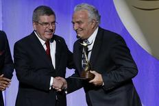 Oct 29, 2015; Washington, USA; Francesco Ricci Bitti of Italy (R) shakes hands with Dr. Thomas Bach of Germany (L), president of the International Olympic Committee, after receiving the ANOC Award for Outstanding Lifetime Achievement during the 2015 ANOC Awards at DAR Constitution Hall. Mandatory Credit: Geoff Burke-USA TODAY Sports