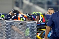 Nov 1, 2015; Arlington, TX, USA;  Seattle Seahawks wide receiver Ricardo Lockette (83) is carted off the field after being injured in the second quarter against the Dallas Cowboys at AT&T Stadium. Mandatory Credit: Tim Heitman-USA TODAY Sports