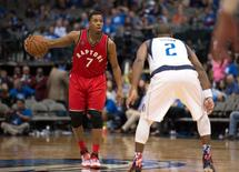 Nov 3, 2015; Dallas, TX, USA; Toronto Raptors guard Kyle Lowry (7) brings the ball up court during the second half against the Dallas Mavericks at the American Airlines Center. Lowry leads his team with 27 points. The Raptors defeat the Mavericks 102-91. Mandatory Credit: Jerome Miron-USA TODAY Sports