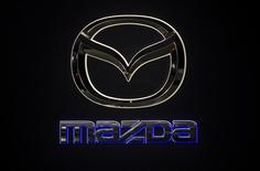 A Mazda logo is pictured at the Jacob Javits Convention Center during the New York International Auto Show in New York April 16, 2014.  REUTERS/Carlo Allegri