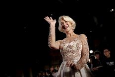 English actress Helen Mirren waves as she arrives at the Tokyo International Film Festival in Tokyo October 22, 2015.  REUTERS/Thomas Peter - RTS5LV2