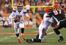 Nov 5, 2015; Cincinnati, OH, USA; Cleveland Browns quarterback Johnny Manziel (2) scrambles with the ball in the second half against the Cincinnati Bengals at Paul Brown Stadium. The Bengals won 31-10. Mandatory Credit: Aaron Doster-USA TODAY Sports