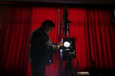 Projectionist Antonio Feliciano, 75, checks his projector before showing a film in Monforte, Portugal May 16, 2015. REUTERS/Rafael Marchante