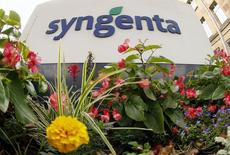 Flowers grow in front of Swiss agrochemicals maker Syngenta's logo at the company's headquarters in Basel August 19, 2015.  REUTERS/Arnd Wiegmann -