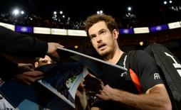 Tennis - Barclays ATP World Tour Finals - O2 Arena, London - 16/11/15 Men's Singles - Great Britain's Andy Murray signs autographs for fans after winning his match against Spain's David Ferrer  Action Images via Reuters / Tony O'Brien Livepic EDITORIAL USE ONLY.