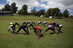 Athletes stretch during a training session on the training grounds in the town of Iten in western Kenya, November 13, 2015. REUTERS/Siegfried Modola