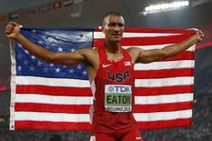 Ashton Eaton from the U.S. reacts after setting a new world record of 9045 points in the men's decathlon during the 15th IAAF World Championships at the National Stadium in Beijing, China August 29, 2015.   REUTERS/Lucy Nicholson