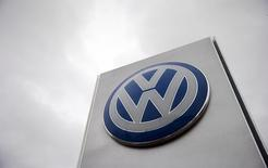 A VW sign is seen outside a Volkswagen dealership in London, Britain November 5, 2015. Volkswagen will have to meet the costs of retesting its vehicles in Britain in the wake of the diesel and carbon dioxide emissions scandals engulfing the German carmaker, Britain's transport minister said on Tuesday. Europe's biggest automaker has previously said around 1.2 million vehicles in Britain have been affected by the scandal. REUTERS/Suzanne Plunkett