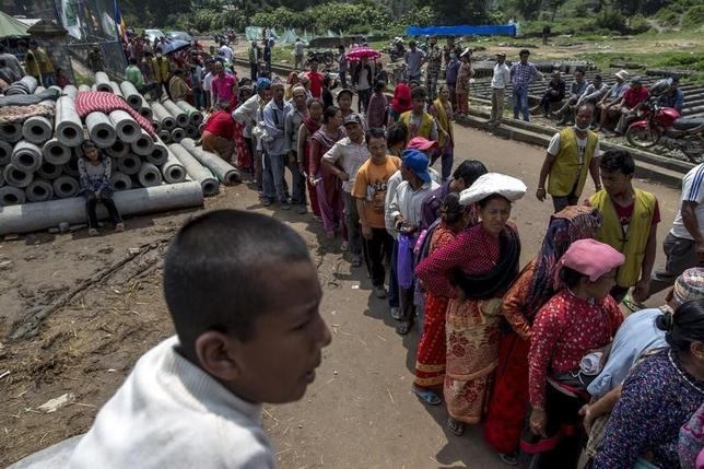 Local residents line up for relief supplies distributed by an international aid organisation after the April 25 earthquake in Bhaktapur, Nepal, May 10, 2015. REUTERS/Athit Perawongmetha