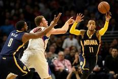 Los Angeles Clippers forward Blake Griffin (32) attempts to pass the ball as he is defended by Indiana Pacers forward C.J. Miles (0) and Pacers guard Monta Ellis (11) during the fourth quarter at Staples Center. The Indiana Pacers won 103-91. Mandatory Credit: Kelvin Kuo-USA TODAY Sports