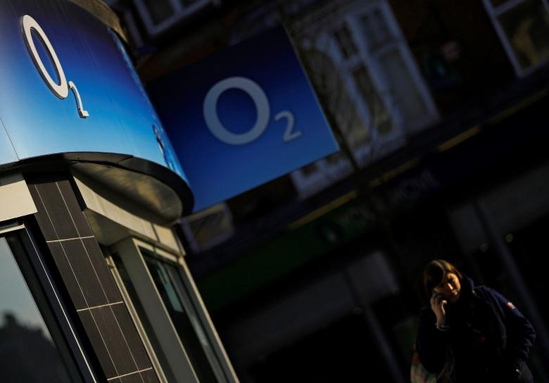 A woman speaks on her mobile telephone outside an O2 shop in Loughborough, central England January 23, 2015. REUTERS/Darren Staples