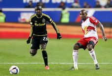 Columbus Crew forward Kei Kamara (23) and New York Red Bulls defender Ronald Zubar (23) in action during the second half of leg two of the Eastern Conference championship at Red Bull Arena.  Vincent Carchietta-USA TODAY Sports