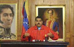 Venezuela's President Nicolas Maduro talks to the media during a news conference at Miraflores Palace in Caracas December 7, 2015. Venezuela's opposition won control of the legislature from the ruling Socialists for the first time in 16 years on Sunday, giving them a long-sought platform to challenge President Nicolas Maduro. REUTERS/Miraflores Palace/Handout via Reuters ATTENTION EDITORS - THIS PICTURE WAS PROVIDED BY A THIRD PARTY. REUTERS IS UNABLE TO INDEPENDENTLY VERIFY THE AUTHENTICITY, CONTENT, LOCATION OR DATE OF THIS IMAGE. THIS PICTURE IS DISTRIBUTED EXACTLY AS RECEIVED BY REUTERS, AS A SERVICE TO CLIENTS. FOR EDITORIAL USE ONLY. NOT FOR SALE FOR MARKETING OR ADVERTISING CAMPAIGNS. THIS IMAGE HAS BEEN SUPPLIED BY A THIRD PARTY. IT IS DISTRIBUTED, EXACTLY AS RECEIVED BY REUTERS, AS A SERVICE TO CLIENTS - RTX1XI3O