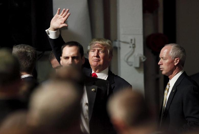 U.S. Republican presidential candidate Donald Trump waves to supporters after a Pearl Harbor Day rally aboard the USS Yorktown memorial in Mount Pleasant, South Carolina, December 7, 2015.  REUTERS/Randall Hill
