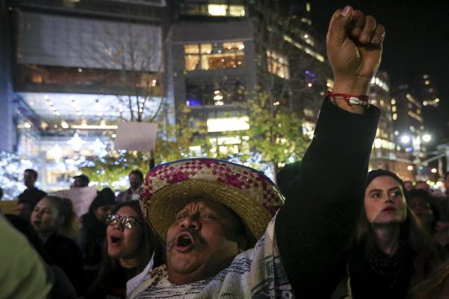 A man in traditional Mexican apparel takes part in an anti-Donald Trump, pro-immigration protest in the Manhattan borough of New York December 10, 2015.     REUTERS/Carlo Allegri