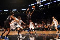 Dec 12, 2015; Brooklyn, NY, USA; Los Angeles Clippers guard Jamal Crawford (11) tosses a shot during the fourth quarter against the Brooklyn Nets at Barclays Center. Los Angeles Clippers won 105-100. Mandatory Credit: Anthony Gruppuso-USA TODAY Sports