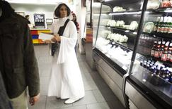 A woman dressed as Princess Leia from Star Wars waits in line to buy food at ComicCon in New York in this October 10, 2013 file photo. REUTERS/Carlo Allegri/Files