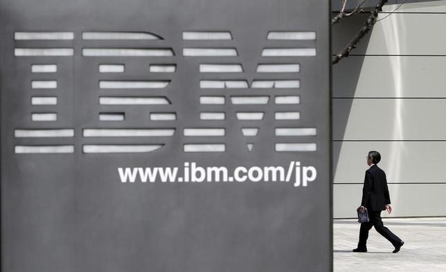 A man walks past the headquarters of IBM Japan in Tokyo March 18, 2010. REUTERS/Toru Hanai/files