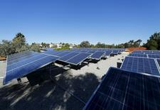 Solar panels are shown on top of a Multifamily Affordable Solar Housing-funded (MASH) housing complex in National City, California November 19, 2015. P REUTERS/Mike Blake