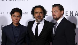 """Director of the movie Alejandro Gonzalez Inarritu (C) poses with cast members Leonardo DiCaprio (R) and Forrest Goodluck at the premiere of """"The Revenant"""" in Hollywood, California December 16, 2015. REUTERS/Mario Anzuoni"""
