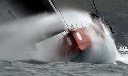 Maxi yacht Comanche powers through heavy swells outside Sydney's harbour during the 71st Sydney to Hobart Yacht race, Australia's premiere bluewater classic race, December 26, 2015. REUTERS/Jason Reed
