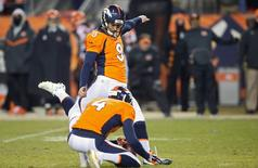 Dec 28, 2015; Denver, CO, USA; Denver Broncos kicker Brandon McManus (8) kicks the winning field goal during the overtime period against the Cincinnati Bengals at Sports Authority Field at Mile High.  The Broncos won 20-17 in overtime. Mandatory Credit: Chris Humphreys-USA TODAY Sports