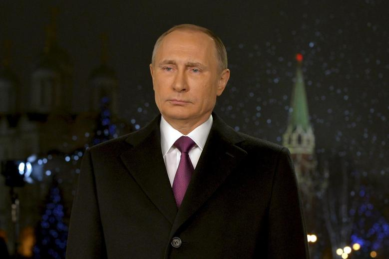 Russian President Vladimir Putin looks on as he delivers his annual New Year address to the nation in Moscow, Russia, December 31, 2015. REUTERS/Alexei Druzhinin/Sputnik/Kremlin