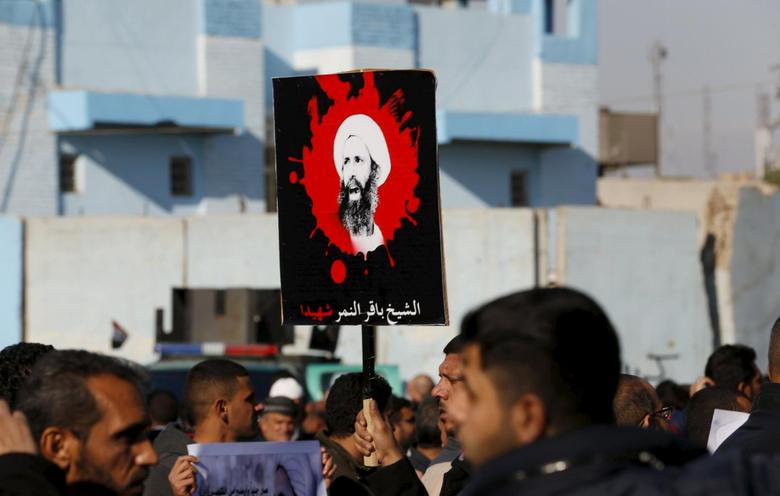 Supporters of Shi'ite cleric Moqtada al-Sadr protest against the execution of Shi'ite Muslim cleric Nimr al-Nimr in Saudi Arabia, during a demonstration in Baghdad January 4, 2016. The words on the poster read, ''The martyr cleric Nimr al-Nimr''.    REUTERS/Thaier Al-Sudani