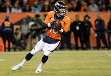 Denver Broncos quarterback Peyton Manning (18) drops back to pass the football in the fourth quarter against the San Diego Chargers at Sports Authority Field at Mile High. The Broncos defeated the Chargers 27-20. Mandatory Credit: Ron Chenoy-USA TODAY Sports