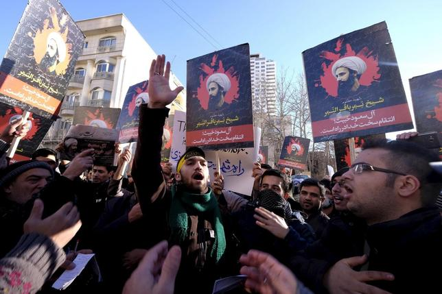 Iranian protesters chant slogans as they hold pictures of Shi'ite cleric Sheikh Nimr al-Nimr during a demonstration against the execution of Nimr in Saudi Arabia, outside the Saudi Arabian Embassy in Tehran January, 3, 2016. REUTERS/Raheb Homavandi/TIMA