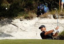 Australia's Jason Day plays a shot from a green side bunker during the final round of the World Cup of Golf at The Royal Melbourne Golf Club in Melbourne November 24, 2013. The World Cup of Golf will be held again in Australia this year. REUTERS/Brandon Malone
