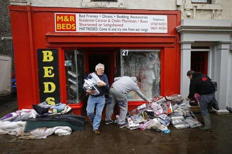 Flood-damaged contents are removed from a business at Newton Stewart in Scotland, Britain December 31, 2015. REUTERS/Darren Staples
