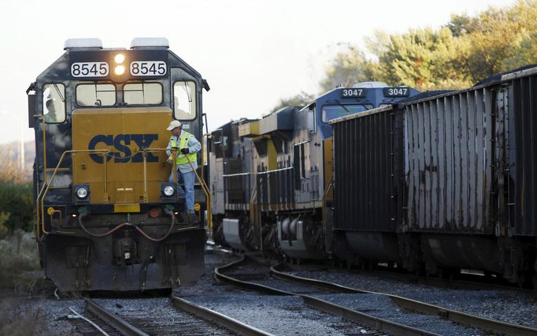 A CSX coal train (R) moves past an idling CSX engine at the switchyard in Brunswick, Maryland in this October 16, 2012, file photo REUTERS/Gary Cameron/Files