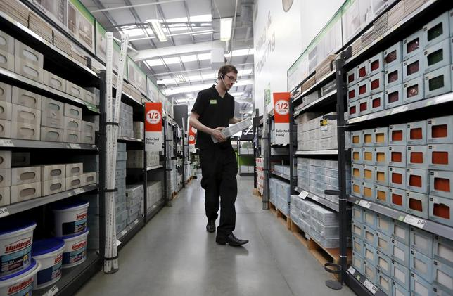 A sales assistant carries tiles at a Homebase store in Aylesford, England in this May 1, 2013 file photo. REUTERS/Luke MacGregor/Files
