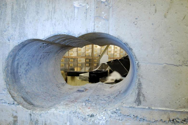 The hole that robbers drilled through the concrete vault during the Hatton Garden heist in London, Britain. is seen in this undated handout photo released to Reuters by the Metropolitan Police on January 14, 2016. REUTERS/Metropolitan Police/Handout via Reuters