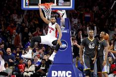Jan 16, 2016; Auburn Hills, MI, USA; Detroit Pistons center Andre Drummond (0) hangs on the rim after a dunk during the fourth quarter against the Golden State Warriors at The Palace of Auburn Hills. The Pistons won 113-95. Mandatory Credit: Raj Mehta-USA TODAY Sports