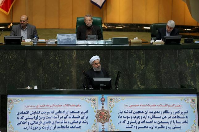 Iranian President Hassan Rouhani (C bottom) speaks at the Iranian parliament before presenting the draft budget for the next Iranian fiscal year in Tehran, January 17, 2016. REUTERS/President.ir/Handout