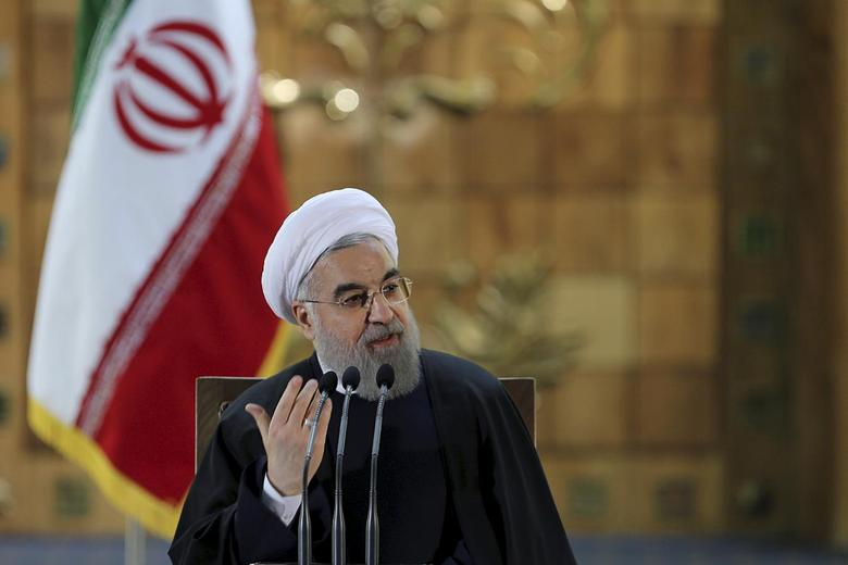 Iranian President Hassan Rouhani gestures as he speaks during a news conference in Tehran, Iran January 17, 2016. REUTERS/President.ir/Handout