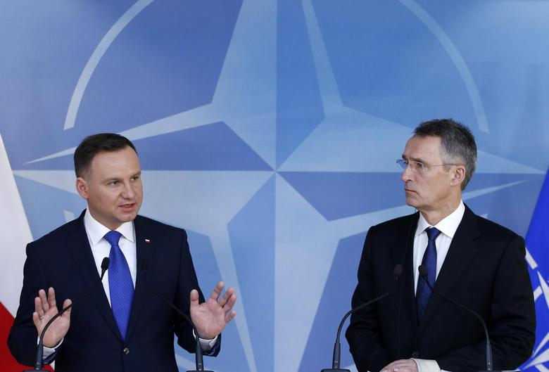 Poland's President Andrzej Duda and NATO Secretary-General Jens Stoltenberg (R) hold a joint news conference at the Alliance headquarters in Brussels, Belgium, January 18, 2016.    REUTERS/Francois Lenoir
