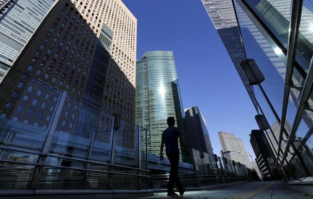 1月21日、1月のロイター企業調査によると、世界的に業界再編が進行する中、経営に危機感を感じている企業が8割に上った。都内で20日撮影(2016年 ロイター/Toru Hanai)