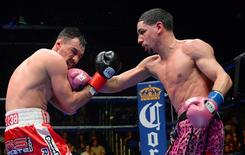 Jan 23, 2016; Los Angeles, CA, USA; Danny Garcia (pink shorts) battles Robert Guerrero (red shorts) during their WBC welterweight boxing title fight at Staples Center. Garcia won by decision. Mandatory Credit: Jayne Kamin-Oncea-USA TODAY Sports