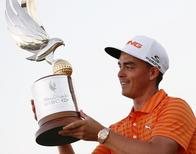Rickie Fowler of the U.S. holds his trophy after winning the Abu Dhabi Golf championship January 24, 2016. REUTERS/Ahmed Jadallah