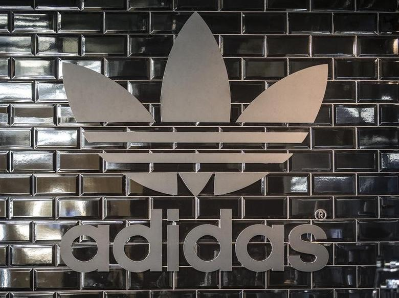 The Adidas logo is pictured in a pop-up store in Berlin in this file photo dated December 2, 2014. REUTERS/Hannibal Hanschke