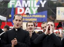Priests shouts slogans during a rally against same-sex unions and gay adoption in Rome, Italy January 30, 2016. REUTERS/Remo Casilli