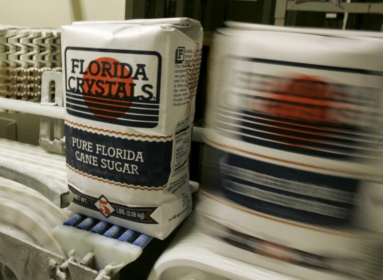 Bags of Florida Crystals cane sugar roll down a conveyer belt after filling at the Florida Crystals Corp. sugar mill, refinery and power plant in Okeelanta, Florida in this July 9, 2008 file photo. REUTERS/Joe Skipper/Files