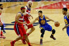 Feb 3, 2016; Washington, DC, USA; Golden State Warriors guard Stephen Curry (30) dribbles the ball as Washington Wizards center Marcin Gortat (13) and Wizards forward Jared Dudley (1) defend in the third quarter at Verizon Center.Mandatory Credit: Geoff Burke-USA TODAY Sports